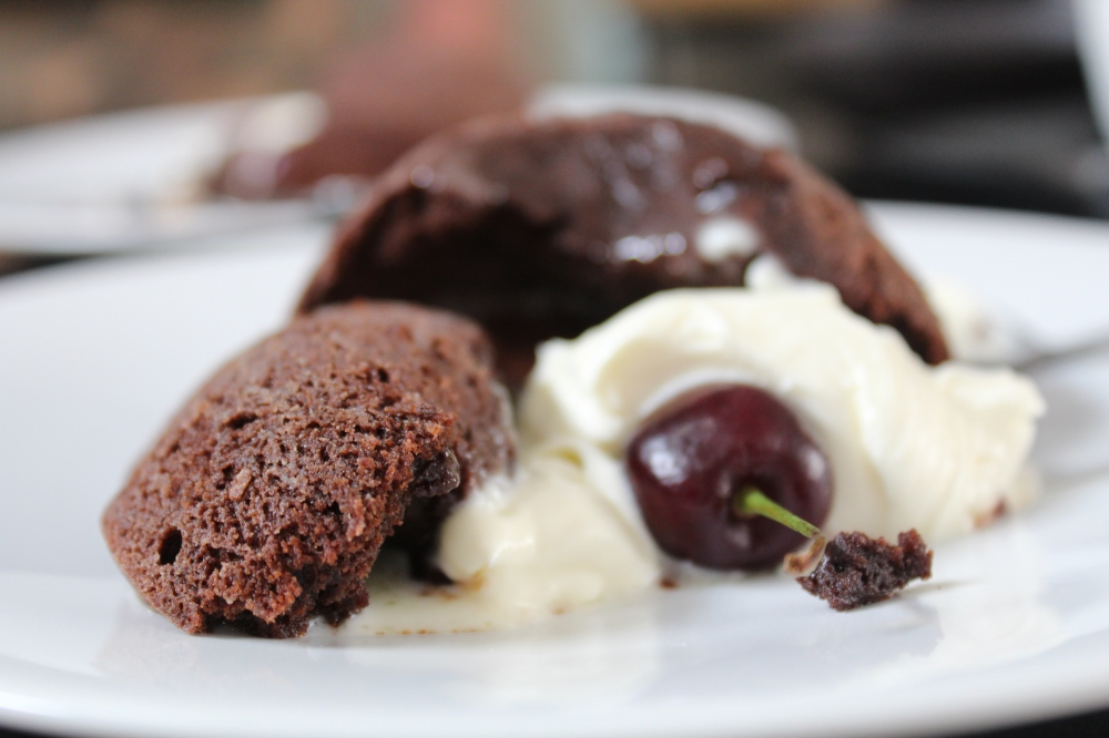 Volcanoes with melted chocolate centres...served with a dollop of cream!