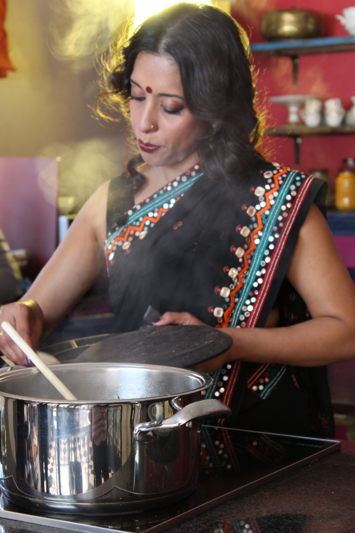 Yudhika on the Mela set preparing the parda veg breyani