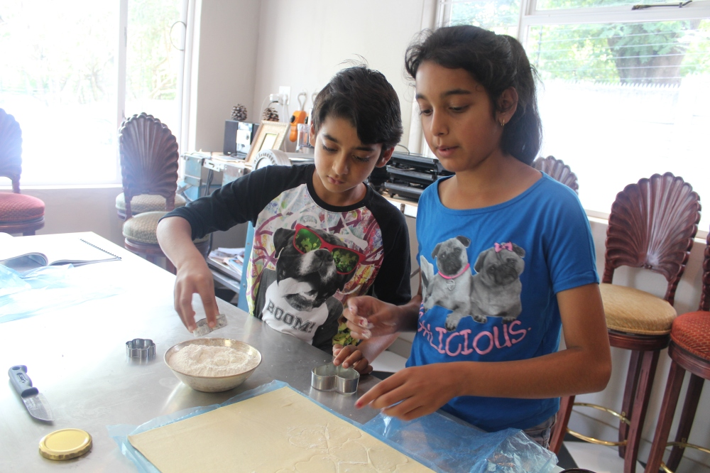 Tanvi and Rushil....helping decorate the pie!