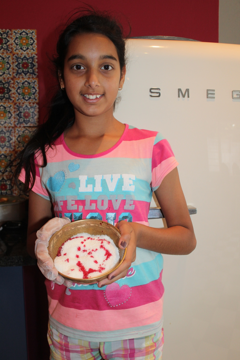 Kitchen assistant on coconut duty...Tanvi Sujanani on the job!